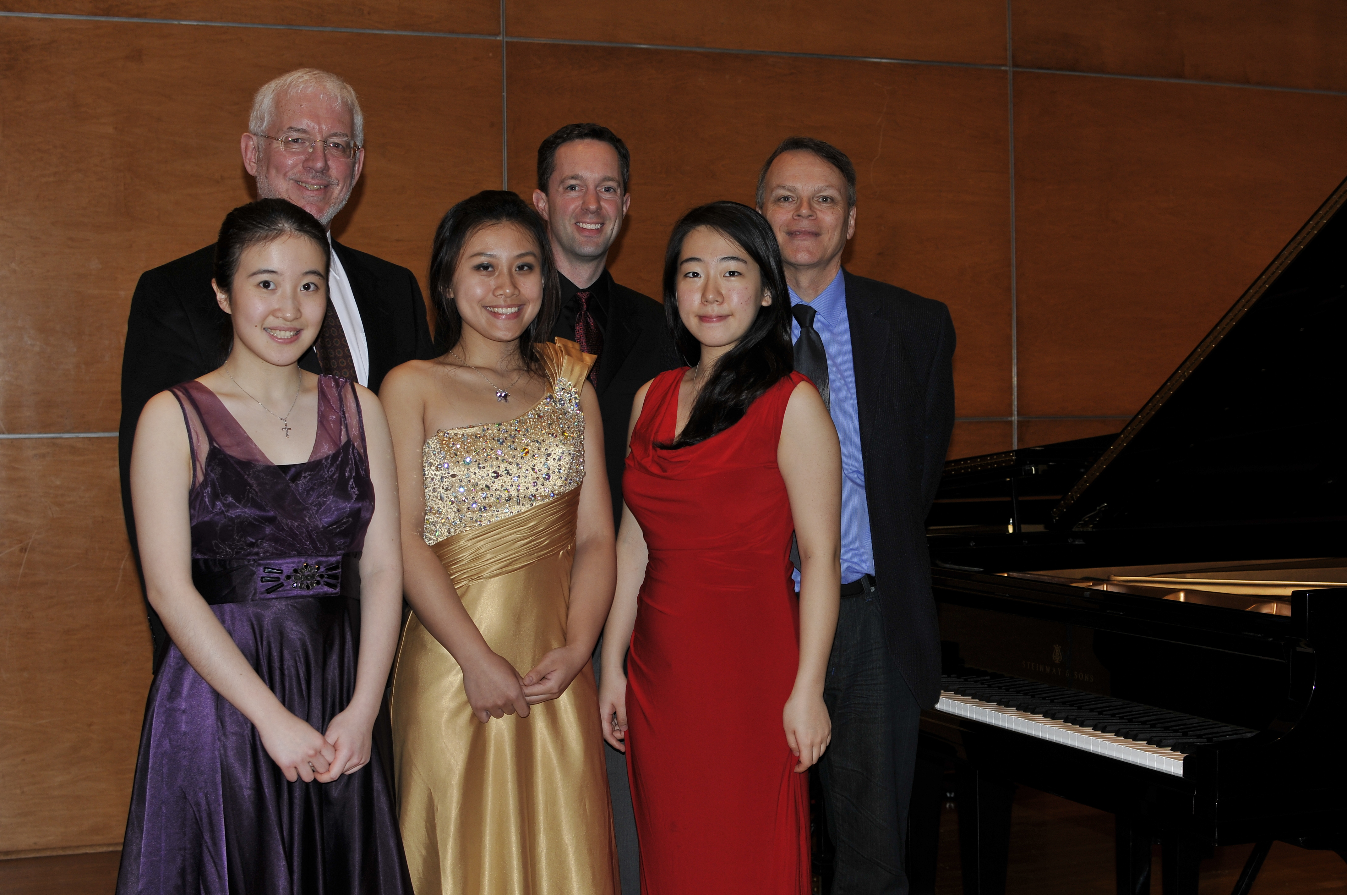 Left to right: Front row: Grace Zhang, second place winner, Grand Prize Winner Xuesha Hu, third place winner Min Ji Lee. Back row: Competition judge Robert Weirich of the UMKC Conservatory of Music, Richardson Symphony music director and conductor Clay Couturiaux and competition judge Robert Shannon of Oberlin College and Conservatory of Music.